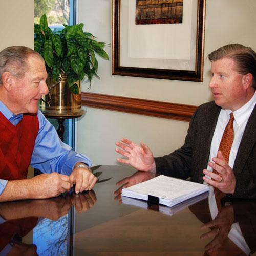 Robert W. Ewing with client